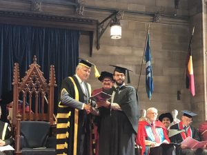 Photo of Jason Israel receiving the inaugural Centre for Gospels Research Essay Prize at the 2018 SCD graduation ceremony.