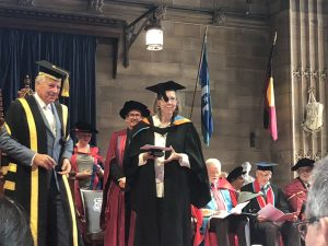 Photo of Margaret Mary Keyes receiving the Dr Brian Murray Memorial Prize and the Dianne Feeney Memorial Prize at the SCD Graduation ceremony 14 April 2018